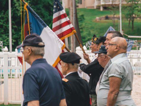 men-standing-near-flags-1582493